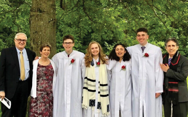 Rabbi Stuart Pollack, at right, with the 2019 Har Sinai confirmation class, and, from left, temple president Alan Kline and music director Susan Sacks.  Photo Courtesy Har Sinai