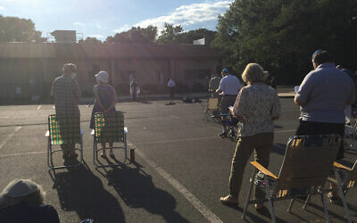 Congregants socially distance in the parking lot of Beth El for Shabbat services on Friday, June 23. Beginning this month, all services are held indoors. Courtesy Beth El