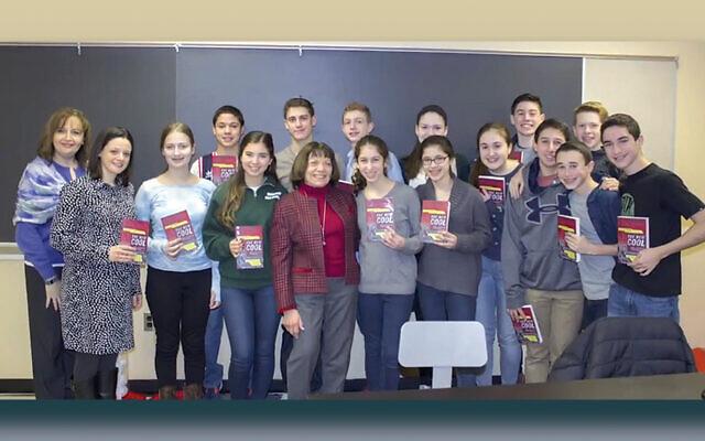 Dr. Lynne B Harrison with students at the Dr. Lynne B Harrison STEM Center at Golda Och Academy