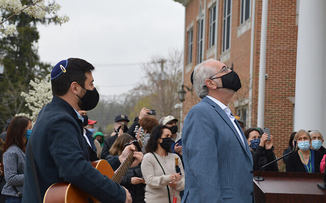 "Rabbi Simeon Cohen, left, and Cantor Perry Fine of Congregation Beth Shalom in Livingston lead the singing of ""Hatikvah"" as the Israeli flag is raised over Livingston Town Hall."