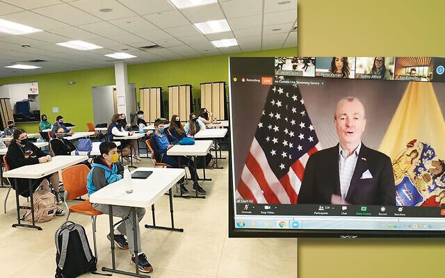 Students at Yeshivat He'Atid join the Zoom visit to Trenton, where they heard from state representatives including Governor Phil Murphy, right.