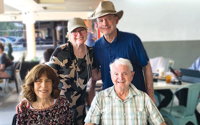 They made it to Florida! Esther and Mark Kook stand behind her sister and brother-in-law, Eve and Maurice Kofman, at lunch in the Sunshine State.