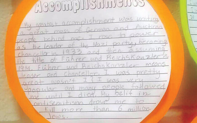 """This is the student project about Hitler's """"accomplishments"""" that was on the wall at the Maugham School in Tenafly."""