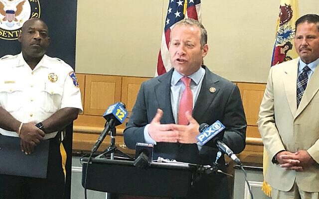 Bergen County Sheriff Anthony Cureton and Teaneck Township Manager Dean Kazinci listen to Congressman Josh Gottheimer.