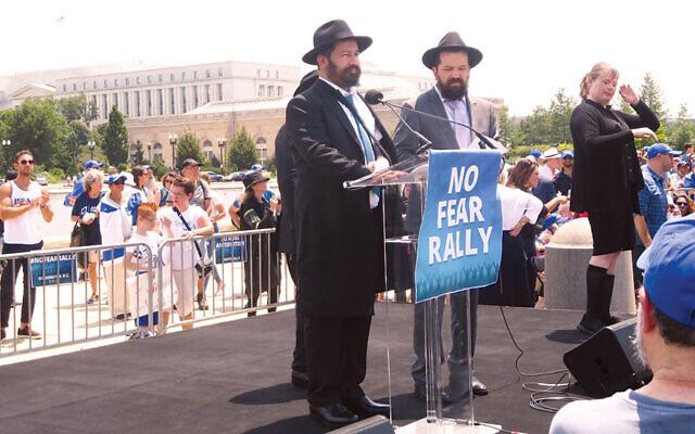 Shlomo Noginski, the Chabad rabbi who was stabbed in Boston, speaks in Washington at a rally against anti-Semitism. (Ron Kampeas)