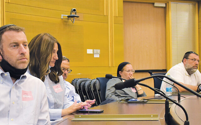 Among the local participants at this Knesset meeting were Rabbi Daniel Alter of the Moriah School in Englewood, left, and Dr. Shoshana and Rabbi Chaim Poupko of Congregation Ahavath Torah in Englewood, right.