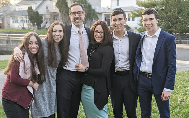 The Hess family, from left, are Dalia, Esti, Rabbi Joshua, Naava, Dani, and Akiva.Courtesy of NJ Sharing Network