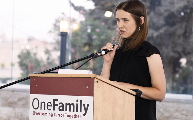Sarah Nachenberg Shalev, the daughter of a woman still in a coma after the Sbarro bombing in 2001, speaks at the 20th memorial of the attack. (Meir Pawlowski)