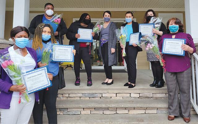 Karen Winter, center, a JFSCNJ RN and home health aide training program coordinator, with recent program graduates. (Courtesy JFSCNJ)