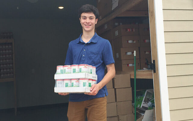 Sam Wexler transfers food from rented storage pods to the nearly completed Food Pantry Storage Facility at Jewish Family Service of Central NJ. (Courtesy JFSCNJ)