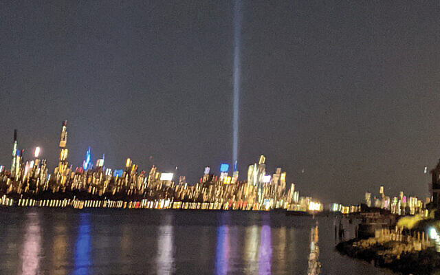 This shaky photograph, taken with an iPhone and great emotion from a balcony in Cliffside Park, shows the Tower of Light over Manhattan on the evening of September 11. (Renee Schlesinger)