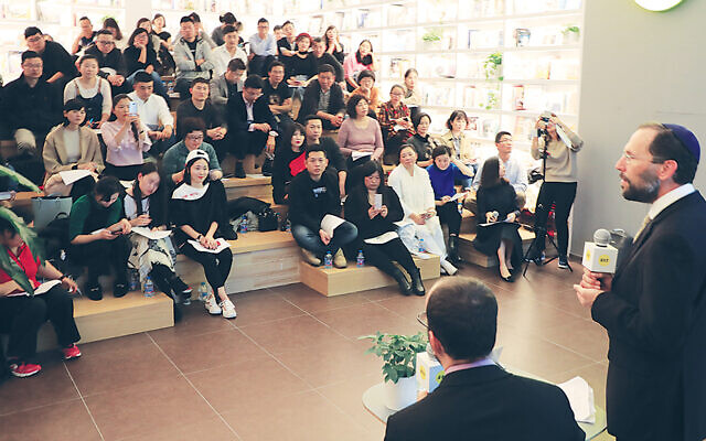 Rabbi Dr. Yakov Nagen speaks to students during a trip to China.
