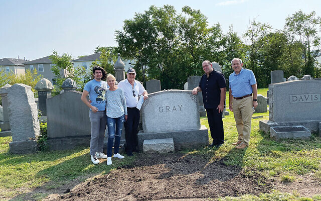 Sharon and Bill Hait of Livingston, and their son Zachary, are to the left of Sharon's grandparents Sam and Anna Gray's grave, and Ira Epstein of the management company Sanford B. Epstein and JCF board president Steve Levy are at the right.
