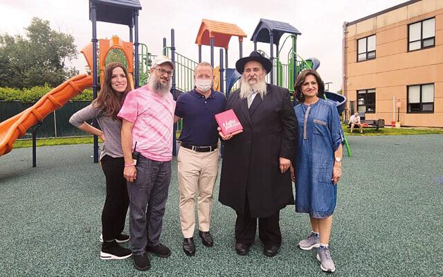 Elke and Rabbi Mendel Zaltzman, directors of the Fair Lawn Jewish Day Camp, Congressman Josh Gottheimer, and Rabbi Mordechai and Shterney Kanelsky of Bris Avrohom. (Courtesy BA)