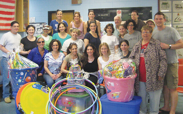 Volunteers for the Jewish Federation of Greater MetroWest's Women's Philanthropy show donations made for children of Union Beach as part of the Federation's recovery efforts post Hurricane Sandy in 2012. Similar efforts are in process now to help victims of the flooding caused by Tropical Storm Ida.