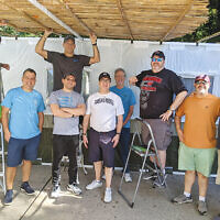 Volunteers from the Men's Club of Congregation Beth Israel in Scotch Plains built the synagogue's sukkah on September 19. Throughout the week-long celebration of Sukkot, which began September 20 at sundown, congregants and religious school students were able to eat in the synagogue's sukkah. (Courtesy CBI)