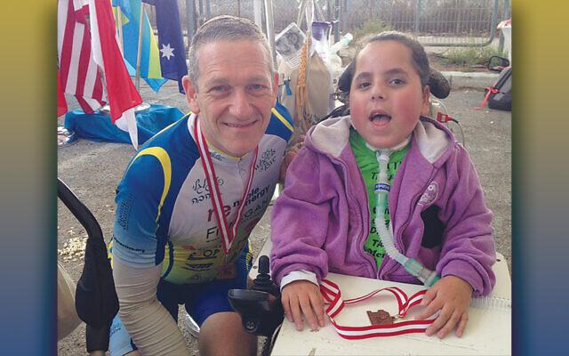 Sam Alexander in Israel with an Alyn Hospital patient (Courtesy Alyn)