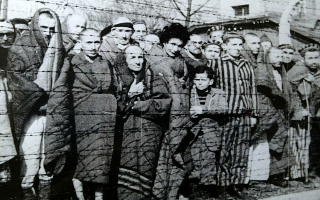 Illustrative: Prisoners at Auschwitz-Birkenau during liberation, in January 1945 (photo credit: Wikimedia Commons)