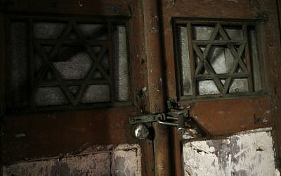 Locked synagogue door (illustration) (phot credit: by Miriam Alster/Flash90)