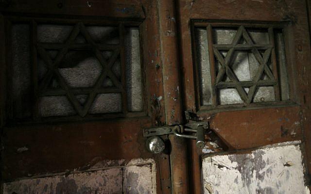 Locked synagogue door (illustration) (phot credit: by Miriam Alster/Flash90)