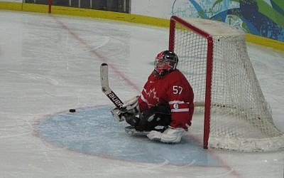 Paul Rosen, goalie for Canada's 2010 Paralympic team, during warmup of their game against Japan.