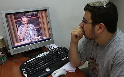 A student at Jerusalem's Yeshiva Machon Meir takes a virtual Torah class over the Internet. (Photo by Nati Shohat/Flash90)