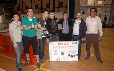 The winning team, along with representatives of World ORT and Misgav High School, celebrate their victory (photo credit: Courtesy)