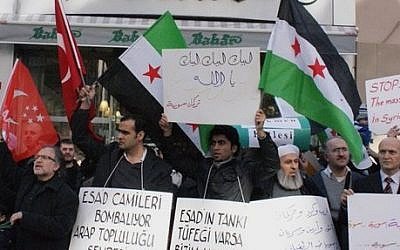 Syrians living in Turkey protest the latest killings by the Syrian regime. (photo credit: AP)