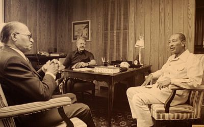 Prime Minister Menachem Begin, left, with President Jimmy Carter, center, and President Anwar Sadat of Egypt at Camp David in September 1978. (photo credit: CC BY-SA Jeff Kubina/Flickr)