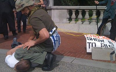 A man dressed as an Israeli soldier manning a 'checkpoint' during an Apartheid Week event at UC Berkley (photo credit: CC-BY James Buck, Flickr)