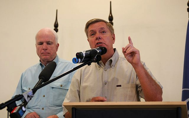 Republican Senators Lindsey Graham, right, and John McCain (photo credit: CC BY isafmedia/Flickr)