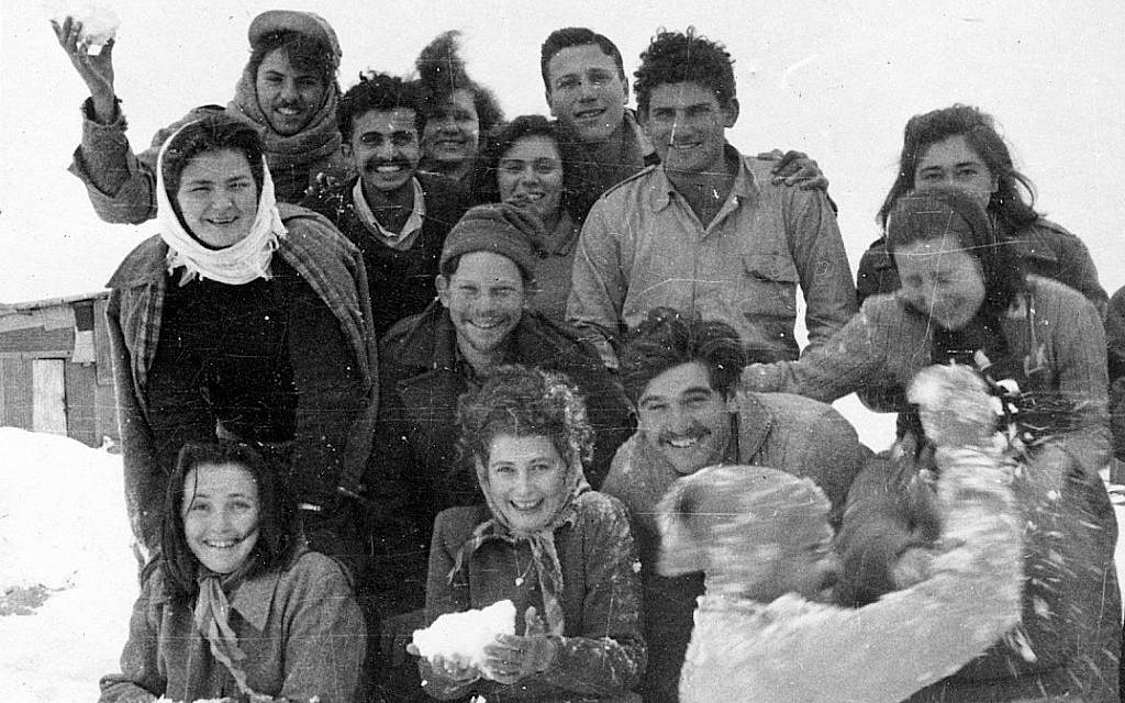 Working alone, Nadav Mann has collected more than 100,000 photographs documenting Israel's early years, an archive unparalleled anywhere in the country. In this photograph, the first settlers at Kibbutz Malkiya celebrate their first snow, circa 1949. From the collection of Ferol and Rivkaleh Atzmon. (photo credit: Courtesy of Nadav Mann/Bitmuna)