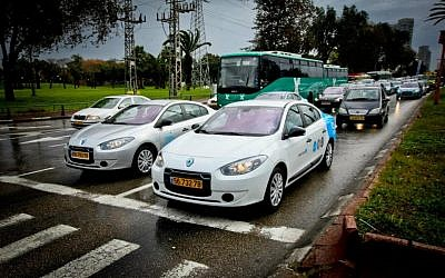 Electric cars, like this Better Place Renault Fluence ZE in Tel Aviv, may soon be a common sight on Israel's streets. (photo credit: CC-BY btrplc, Flickr)