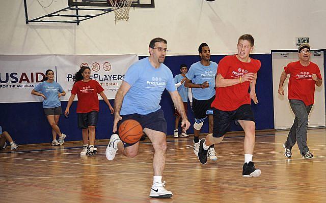 US Ambassador Dan Shapiro on the basketball court (photo credit: David Azagury/US Embassy Tel Aviv)