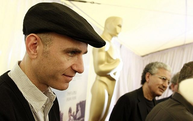 """Footnote"" director Joseph Cedar stands in front of a giant Oscar (photo credit: AP Photo/Matt Sayles)"