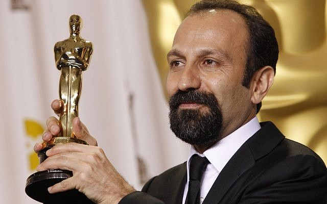 Asghar Farhadi, from Iran, poses with his award for best foreign language film. (photo credit: AP/Joel Ryan)