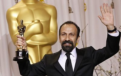 "Asghar Farhadi, from Iran, poses with his award for best foreign language film for ""A Separation"" during the 84th Academy Awards. (photo credit: AP Photo/Joel Ryan)"