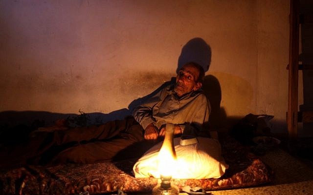A house in Gaza lit by a gas lamp during an electric shortage (photo credit: Wissam Nassar/Flash90)