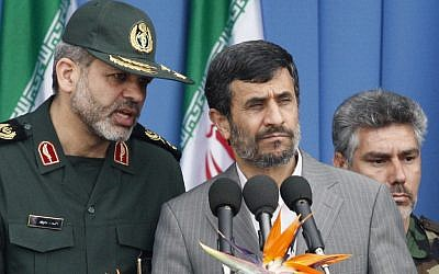 Iranian Defense Minister, Gen. Ahmad Vahidi (left), pictured with President Mahmoud Ahmadinejad during a 2010 army parade (photo credit: AP Photo/Vahid Salemi)