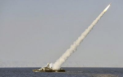 Illustrative: An Iranian navy vessel launches a missile during a drill in the Sea of Oman, in January 2012. (AP/ISNA, Amir Kholousi)