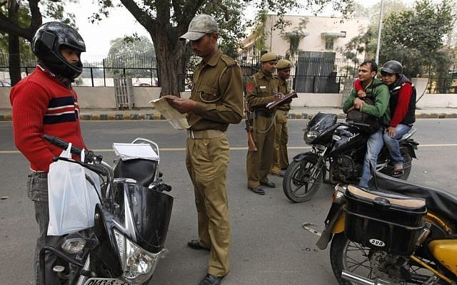 Illustrative photo of Indian police checking the ID of motorcyclists outside the Israeli Embassy in New Delhi after a terror attack in February 2012 (AP/Saurabh Das)