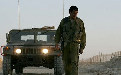 An IDF scout looks for tracks along the Israel-Egypt border (photo credit: Mosh Shai/Flash90)