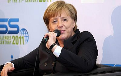 German Chancellor Angela Merkel speaks in Tel Aviv, in February (photo credit: Roni Schutzer/Flash90)