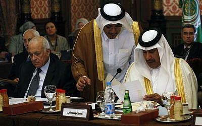 Arab League chief Nabil Elaraby, left, and Qatari Prime Minister Sheikh Hamad Bin Jassim Althani, right, are seen during a meeting in Cairo, September 1, 2013. (Photo credit: AP/Nasser Nasser)
