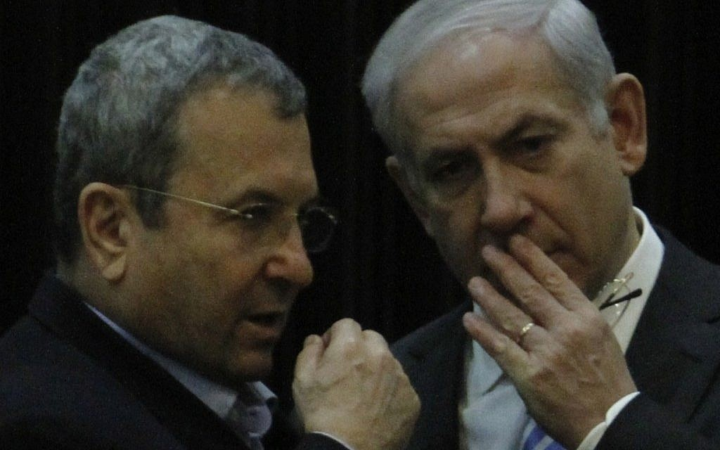 Ehud Barak and Benjamin Netanyahu, pictured in the Knesset in December 2011. (Miriam Alster/Flash90)