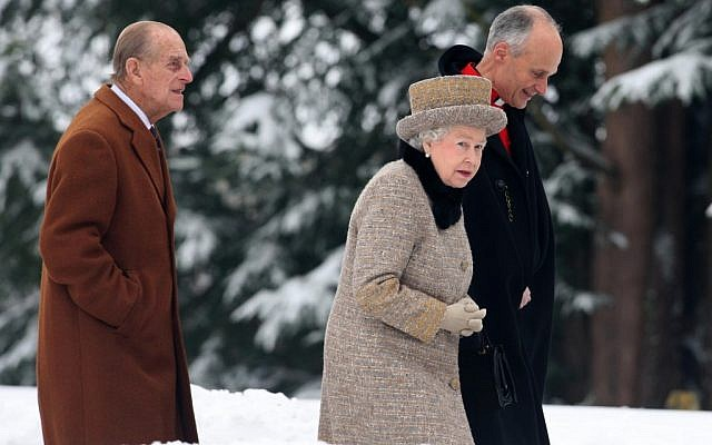 The queen braved the cold and snow to attend church Sunday on the eve of her Diamond Jubilee anniversary. The 85-year-old monarch marks 60 years on the throne on Monday.  (photo credit: AP Photo/PA, Chris Radburn)