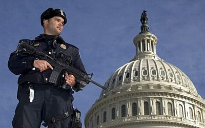 A Capitol Police officer stands guard in front of the US Capitol (photo credit: AP Photo/Manuel Balce Ceneta)
