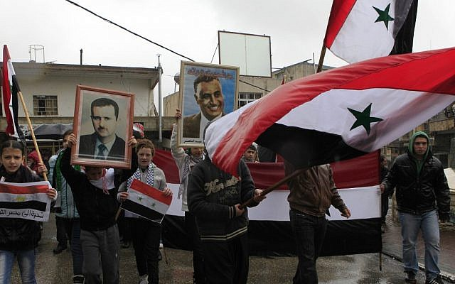 Illustrative: Druze march in support of Syrian President Bashar Assad in the town of Majdal Shams on the Golan Heights. (Tsafrir Abayov/Flash90/File)