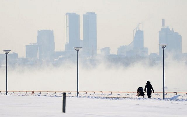 Tallinn's skyscrapers loom above a frozen expanse of white. The temperature in Tallinn plummeted to -28 Celsius (-18.4 Fahrenheit) (photo credit: AP/Timur Nisametdinov/NIPA)