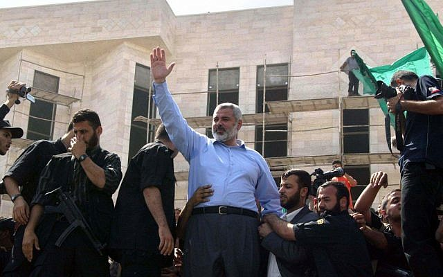 Ismail Haniyeh waves to supporters during a Hamas rally in Gaza (photo credit: Ahmad Khateib/Flash90)